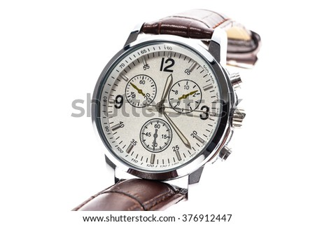 Mens luxury round swiss mechanical wrist watch with leather wristband strap. Chronograph or tachometer isolated on white. High resolution photo. - stock photo