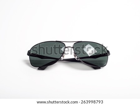 Mens metal framed sunglasses on light background front view with light reflections - stock photo