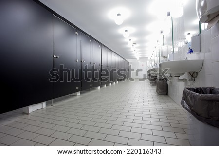 Mens restroom in an public building in white and black doors - stock photo