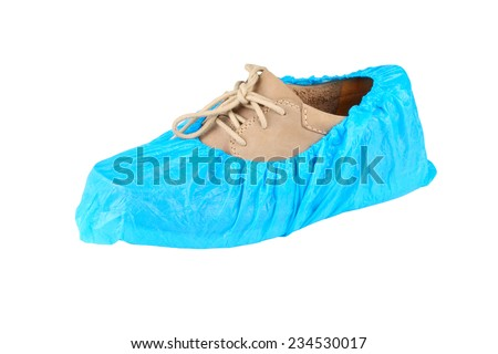 mens shoe in overshoes isolated on white background  - stock photo
