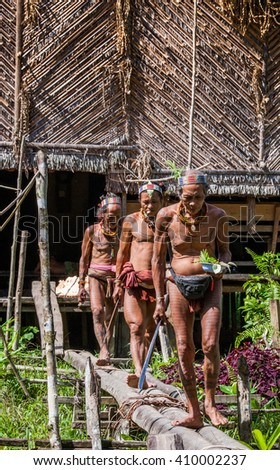 MENTAWAI PEOPLE, WEST SUMATRA, SIBERUT ISLAND, INDONESIA ?? 03 OKTOBER 2011: Men of the Mentawai tribe go hunting. 03 October, 2011. West Sumatra, Siberut island, Indonesia. - stock photo