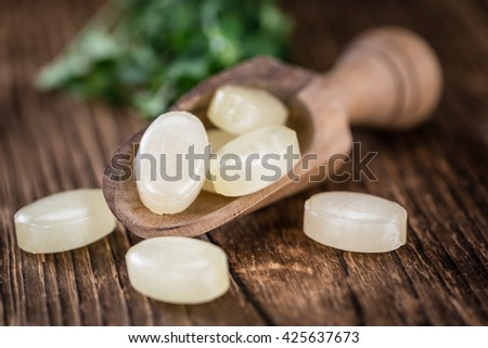 Menthol Candies on an old wooden table (close-up shot; selective focus) - stock photo