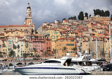 MENTON, FRANCE - APRIL 30, 2015: Menton cityscape and harbour on April 30, 2015 in Menton, France. It is a popular tourist resort on French Riviera. - stock photo