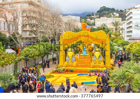 MENTON, FRANCE - FEBRUARY 14, 2016: Sphinx and Cleopatra made of lemons and oranges in the famous Fete du Citron in Menton, France. The famous fruit garden receives 230,000 visitors a year. - stock photo