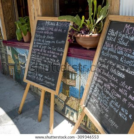 Menu blackboards in a restaurant, Valparaiso, Chile - stock photo