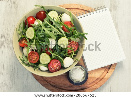 menu, food recipe, blank notepad and vegetable salad - stock photo