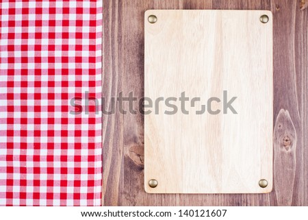Menu or recipe sign board, tablecloth on wooden background - stock photo