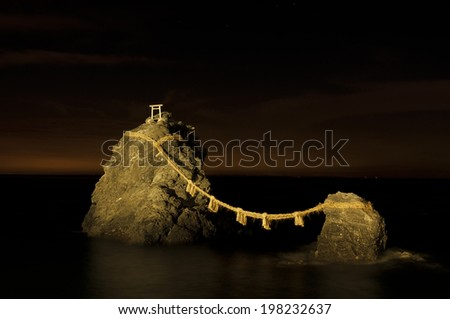 Meoto Iwa or the Loved one-and-loved one Rocks, are a couple of small rocky stacks in the sea off Futami, Mie, Japan - stock photo