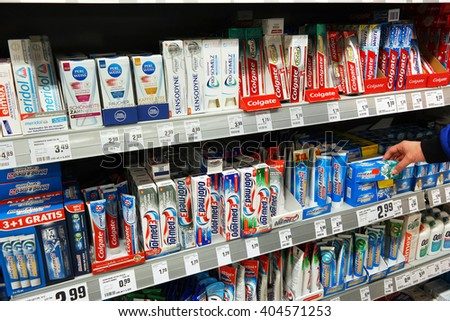 MEPPEN, GERMANY - MARCH 2, 2016: Variety of tooth paste brand in the shelves at the oral care department of a Rewe supermarket. Photo taken on March 2, 2016 in Meppen, Germany - stock photo