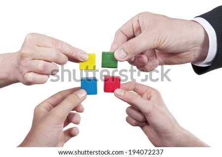 Merging isolated building blocks with different hands - stock photo