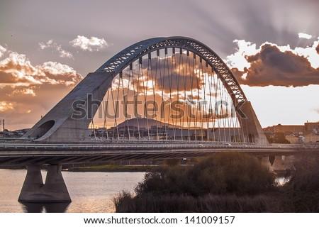 Merida, November 2012. Lusitania bridge over Guadiana river. Santiago Calatrava architect, built in 1991 on concrete and steel. 480 meters. 190 meters of  arch. - stock photo
