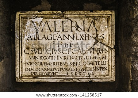 Merida, November2012. Tombstone plate in ancient Latin language. Archeological site Roman ruins. UNESCO World Heritage Site. - stock photo