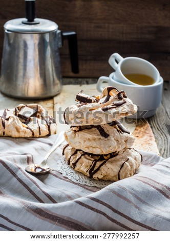 meringue cake with chocolate, caramel and nuts, dessert, rustic, french,selective focus - stock photo
