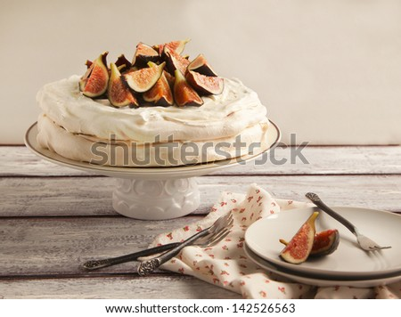 Meringue cake with figs - stock photo