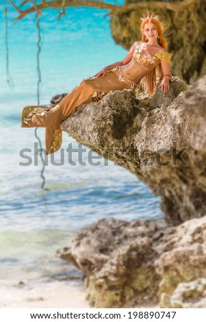mermaid on the rock - stock photo