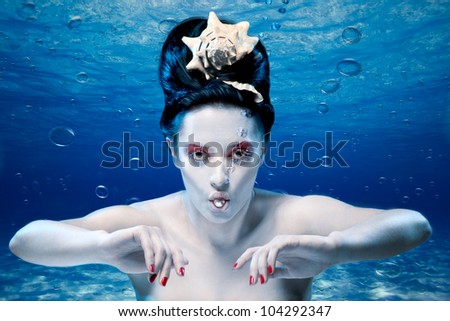 mermaid under water with a pearl - stock photo
