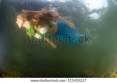 Mermaid underwater - stock photo