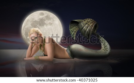 Mermaid with Full Moon - stock photo
