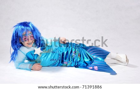 mermaid with long, flowing blue hair. - stock photo