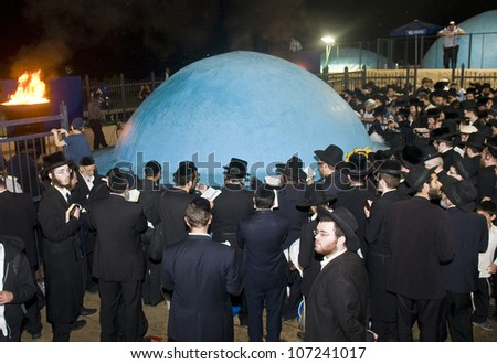 MERON , ISRAEL - MAY 10 : Orthodox Jews celebrates Lag Ba'omer in Bar Yochai tomb in Meron , Israel on May 10 2012 , Lag Ba'omer is a Jewish holiday in wich it is customary to light bonfire - stock photo