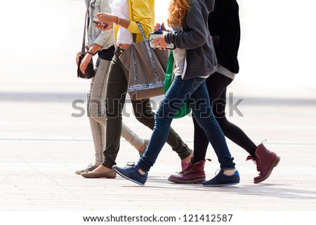 Merry band of teenagers. Urban landscape. - stock photo