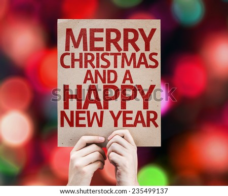 Merry Christmas And a Happy New Year card written on colorful background with defocused lights - stock photo