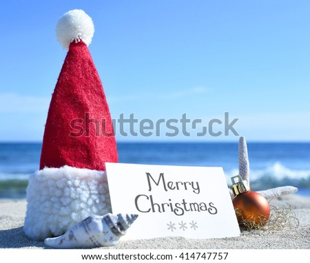 Merry Christmas card with christmas decoration and sea shell on a tropical beach. Christmas holidays. Greeting card on the beach.  - stock photo