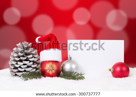 Merry Christmas card with ornaments, red balls, hat decoration, snow and copyspace - stock photo
