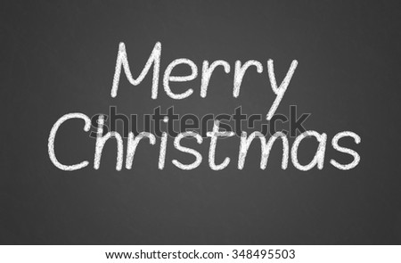 Merry Christmas - made with white chalk on a blackboard - stock photo