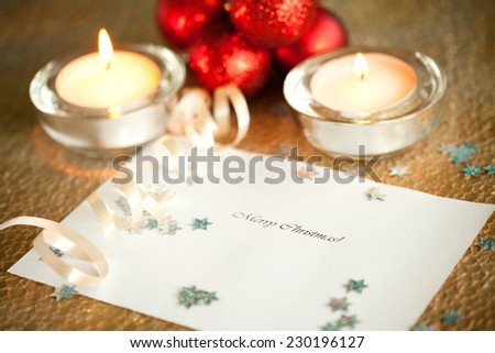 Merry Christmas note surrounded by christmas decoration  - stock photo