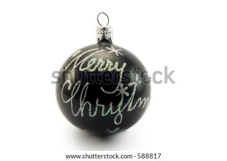 Merry christmas on black glass ball - stock photo