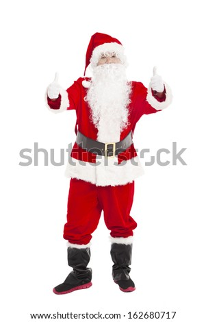 merry Christmas Santa Claus holding  with thumb up - stock photo