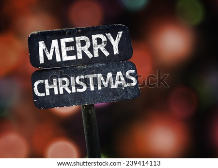 Merry Christmas sign with colorful background with defocused lights - stock photo
