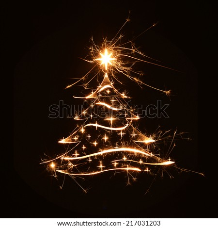 Merry Christmas tree greeting in sparkly bright design on black background with copy space. - stock photo