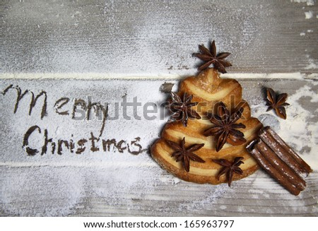 Merry Christmas with cookie fir-tree on the table - stock photo