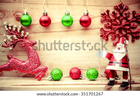 Merry Christmas with Santa Claus and a reindeer - stock photo