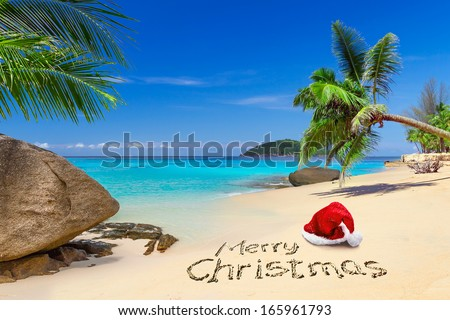 Merry Christmas with santa hat on the tropical beach  - stock photo