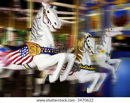 merry-go-round at a theme park - stock photo