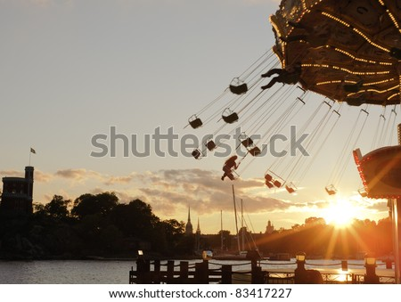 Merry go round in the amusement park Grona Lund in Stockholm - stock photo