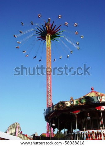 Merry-go-round with people during ride - stock photo