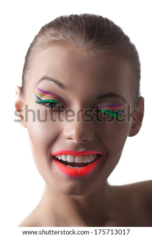 Merry young disco girl winks at camera - stock photo