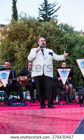 MERSIN,TURKEY-MAY 10, 2015:Mersin Int. music festival, Turkish tenor Hakan Aysev, the singer who has managed to increase the number of new listeners of classical music in Turkey,(outdoor free concert) - stock photo