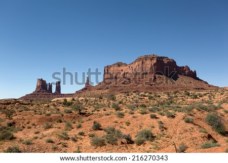 mesa and needles created by wind erosion in Monument Valley Utah  - stock photo