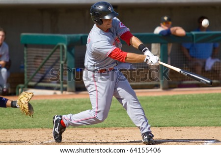 MESA, AZ - OCT. 19: Devin Mesoraco, the Cincinnati Reds' first-round pick in 2007, bats for the Peoria Saguaros in an Arizona Fall League game Oct. 19, 2010 at Phoenix Municipal Stadium. - stock photo