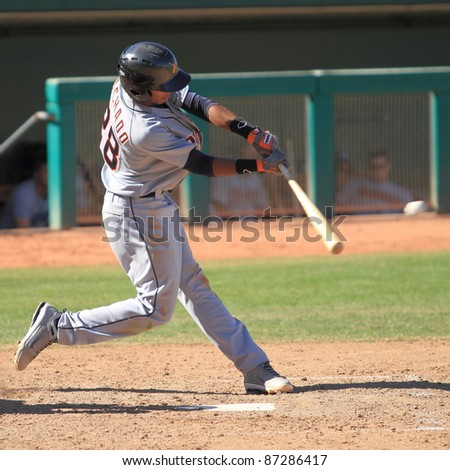 MESA, AZ - OCTOBER 17: Dixon Machado, a Detroit Tigers prospect, bats for the Salt River Rafters in an Arizona Fall League game Oct. 17, 2011 at HoHoKam Stadium. Machado hit a triple and later scored. - stock photo