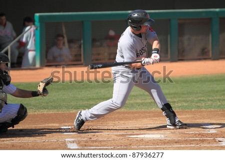 MESA, AZ - OCTOBER 26: Juan Carlos Linares, a Boston Red Sox prospect, bats for the Scottsdale Scorpions in an Arizona Fall League game Oct. 26, 2011 at HoHoKam Stadium, Mesa, AZ. Linares homered. - stock photo