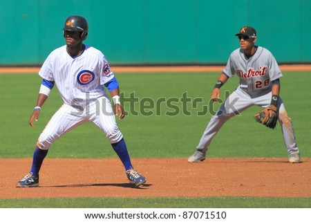 MESA, AZ - OCTOBER 17: Junior Lake, a Chicago Cubs prospect, takes his lead in an Arizona Fall League game Oct. 17, 2011 at HoHoKam Stadium. Detroit Tigers prospect Dixon Machado plays second base. - stock photo
