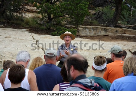 MESA VERDE, CO - JULY 26: A Park Ranger gives visitors a pep talk before leading them down to the awe-inspiring ruins of Cliff Palace July 26, 2008 in Mesa Verde, CO. - stock photo