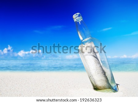 Message in a bottle on a beach. - stock photo