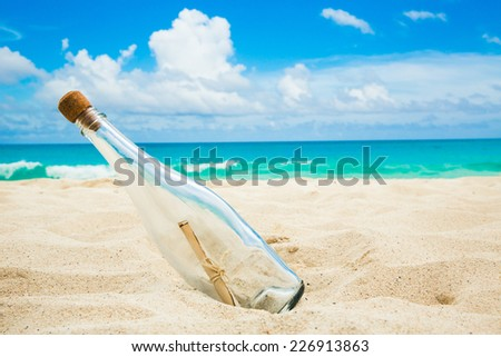 Message in a bottle on a shore - stock photo